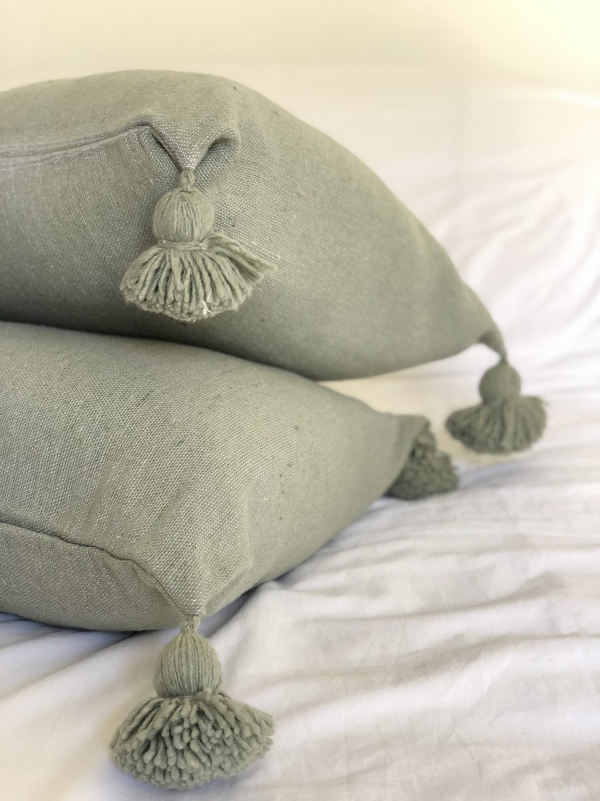 coussin pompons